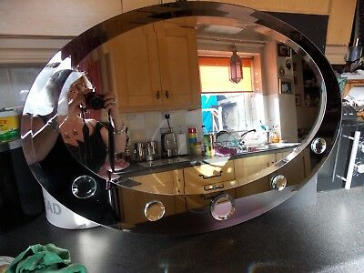 Vintage type  mirror oval shape with small round detail  Smokey and clear bevel