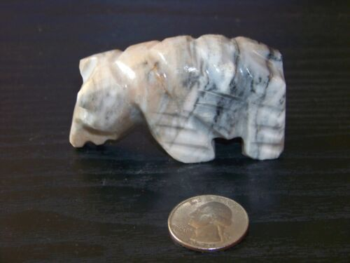 Hand-carved white/grey stone standing bear