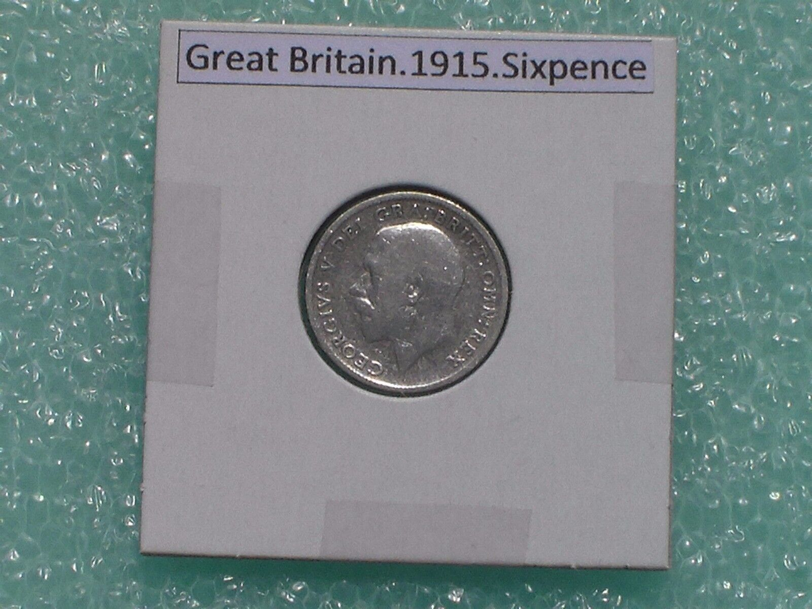 GREAT BRITAIN - 1915 SIXPENCE - PREDECIMAL COIN. - $5.00