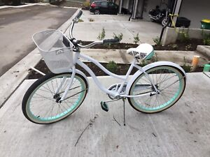 Huffy Cruiser Bike with a basket attached