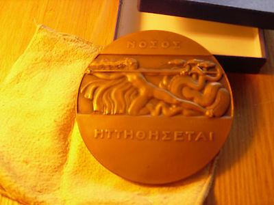 Bronze medallion of nude Woman fighting serpent P M Dammann