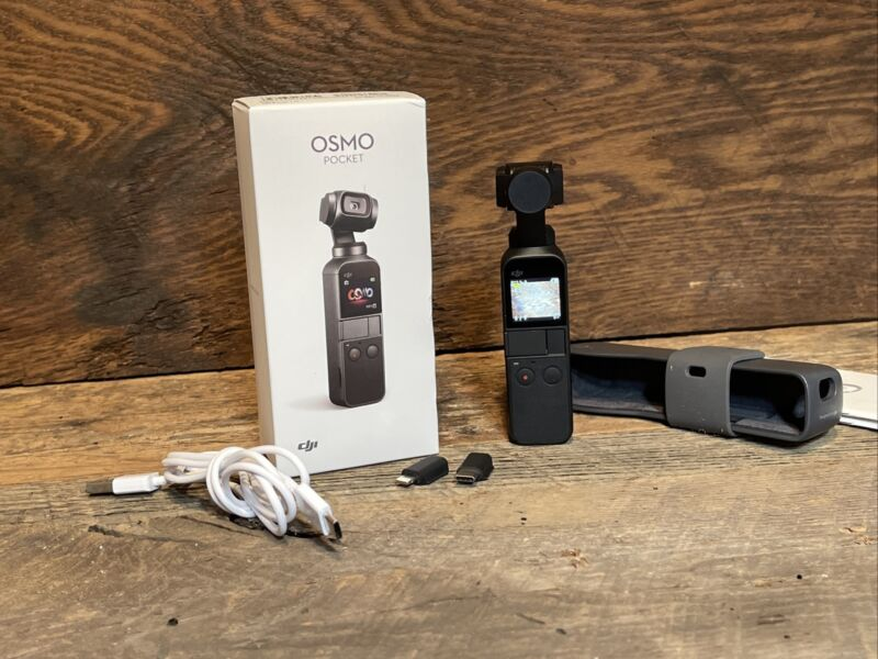 DJI Osmo Pocket 1 - 3-Axis Gimbal Stabilized Handheld Camera, 4K Video 12mp Cam