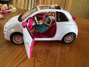Barbie car and 2 barbies