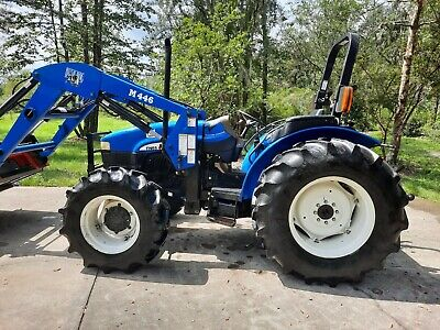 New Holland Tractor Tn65 4x4-65hp- Hd Loader W Universal Quick Tack Reduced