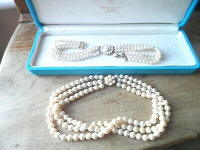 Two simulated pearl chokers in box.