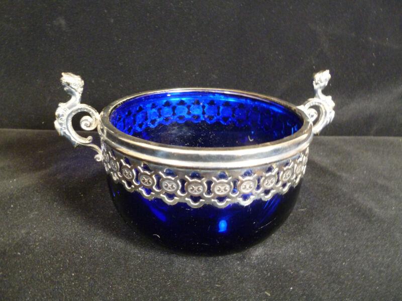 WMF COBALT BLUE GLASS BOWL WITH FIGURAL SILVER PLATED RIM & HANDLES – CIRCA 1900