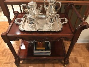 Mahogany anttea wagon and silver plated tea set