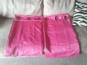 Pair of hot pink black-out curtains