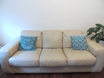 Good used condition three-seater cream leather couch or sofa