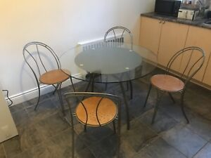 Glass dining table set with four chairs