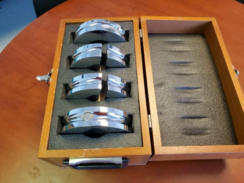 Four 10 lb calibration weights