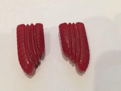 VINTAGE PAIR OF CARVED RED BAKELITE DRESS CLIPS