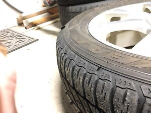 Good Year Ultra Grip 235/55r17 on alloy wheels LIKE NEW!!!