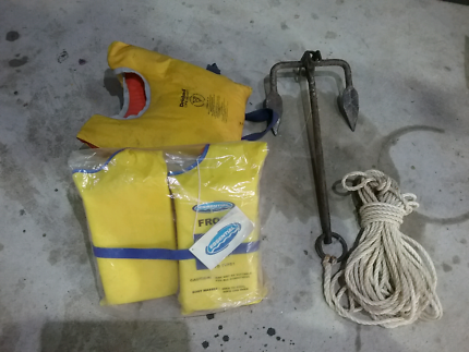 Anchor and 2 life jackets 1 new