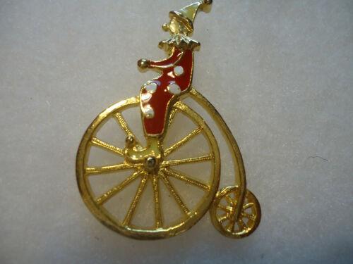 Vintage/nos gold tone enamel Clown Bike pin