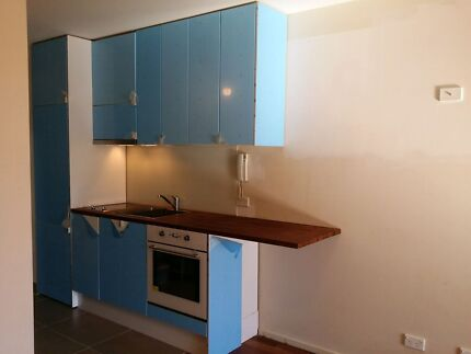 New Ikea kitchen still covered in blue protective film rangehood  Carlton Melbourne City Preview