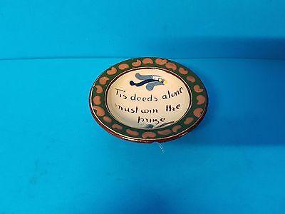 Tis deeds alone must win the prize, small dish.Torquay Devon Motto