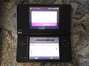 Nintendo DSi XL and games for sale