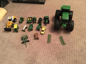 John Deere Lot Of tractors and toys