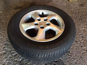 Mazda Protege wheels with all season tires 205/65-15