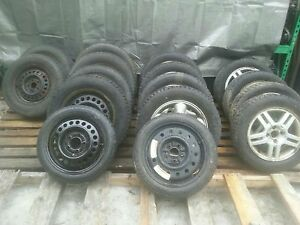 assortment of tires and rims