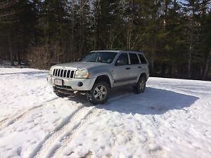 2006 Jeep Grand Cherokee with plow