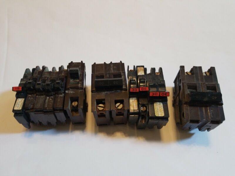 """LOT OF (11) """"USED"""" FEDERAL PACIFIC STAB-LOC  15-40 AMP CIRCUIT BREAKERS."""