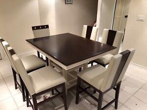 Like new. Beautiful counter table and 6 chairs
