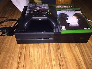 Xbox one with controller mic and 3 games