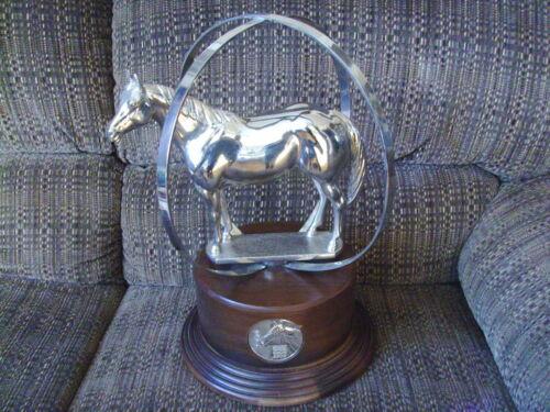 "AQHA World Globe horse trophy, 2011, 17"" x 12"" shiny silver color, last one"
