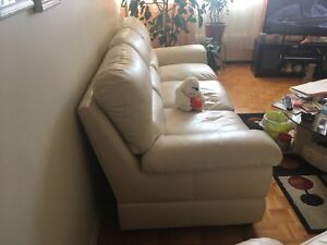 2 set of leather cream seat couches.