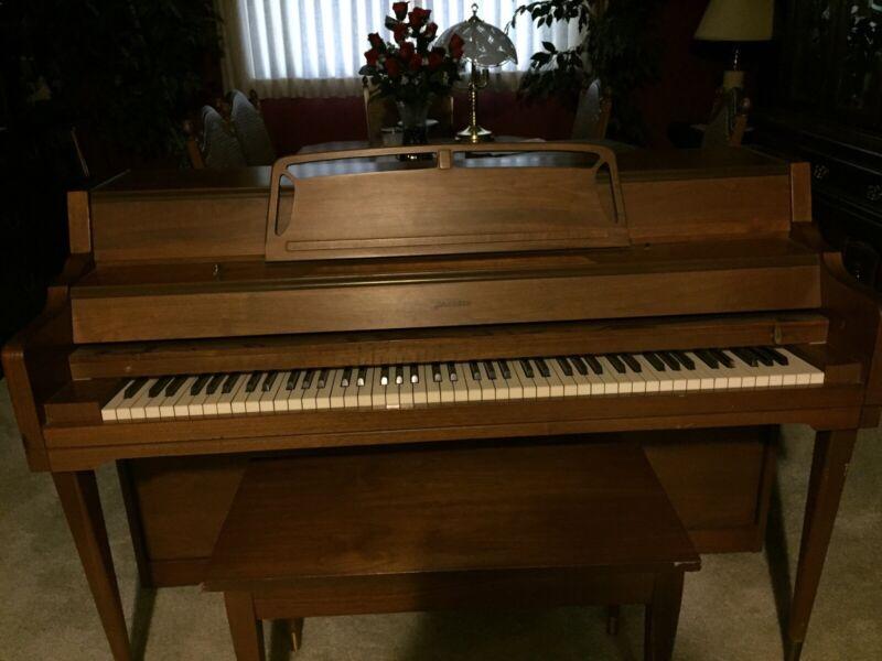 piano - brand - Janssen - spinnet style- oak color. Last tuned June 2017.