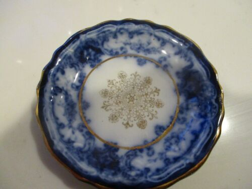 Antique blue white and gold trim butter pat. England