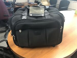 Large briefcase with detachable roll-on hard case