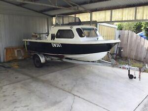 15ft savage Tasman half cab Boat