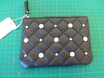 Black purse wallet with decorative studs on quilted design front, zipped. New