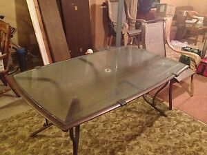 Glass topped patio table