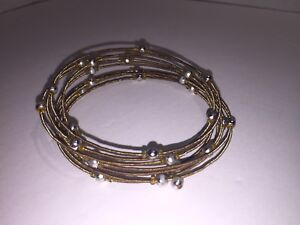 Gold Twist Around Bangle with Silver Beads