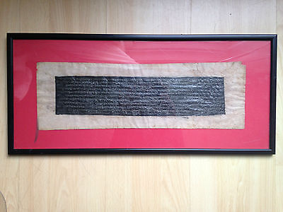 Antique Tibetan manuscript written in silver ink on a black background