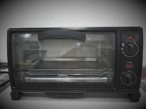 Sunbeam mini bake & grill compact oven. Perfect for quick meals.