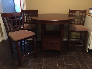 Solid wood pub style table and 3 chairs