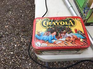 Sealed vintage crayola tin with crayons