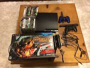 PS3 160 GB console , 2 dual shock controllers. 21 games