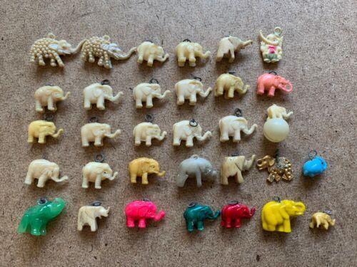 VINTAGE ELEPHANT CELLULOID CARVED STONE GLASS METAL CHARM CRACKER JACK LOT OF 32