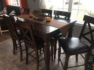 Bar height table and 6 chairs
