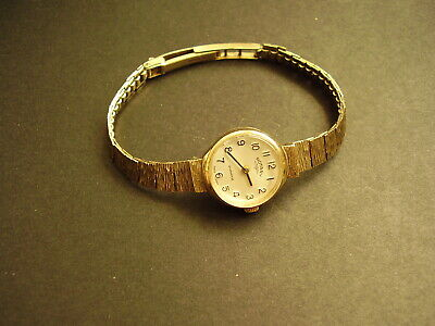 9CT GOLD LADIES QUARTZ ROTARY WATCH WITH SOLID 9CT GOLD ADJUSTABLE STRAP