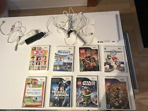 Wii with 8 games including mariocart with 2 controller