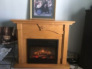 Oak fireplace mantle and insert