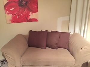 Sofa and loveseat plus foot rest