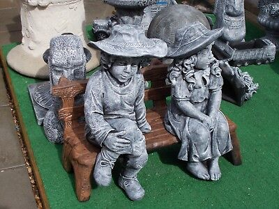 Large Boy and girl on a bench concrete garden ornament